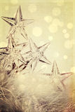 Holiday star lights with festive background. Vintage holiday star lights with festive background Royalty Free Stock Images