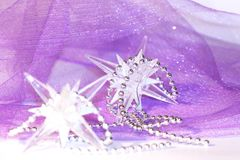 Holiday stars on violet background Royalty Free Stock Images