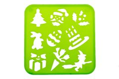 Holiday stencil shapes. On a green background Royalty Free Stock Images
