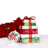 Holiday Still Life. With presents, poinsettias and ornaments. Square format Royalty Free Stock Photo