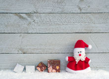 Holiday still life with Santa Claus and presents Royalty Free Stock Images