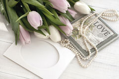 Holiday still life with tulips and pearls Royalty Free Stock Photos