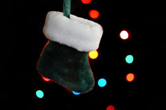 Holiday Stocking. Very small sized holiday stocking hanging with lights in background Royalty Free Stock Image