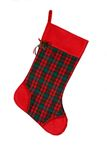 Holiday Stocking. Red holiday stocking hanging on a white background Stock Image
