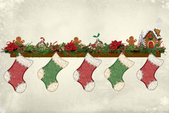Christmas stockings hanging on mantelpiece Stock Photography
