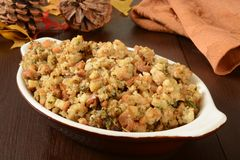 Holiday stuffing. A small casserole dish of herbal holiday stuffing in turkey juice Stock Image
