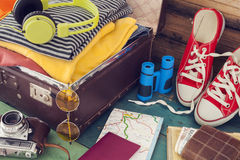 Holiday suitcase. The holiday suitcase with clothing Stock Images
