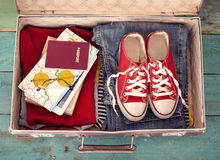 Holiday suitcase. The holiday suitcase with clothing Royalty Free Stock Photo