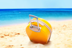 Holiday Suitcase Tropical Beach Relax Summer Day. Holiday Accessory Yellow Suitcase on Tropical Beach Blue Sea Sand Relax Sunny Summer Day Horizon Escape Concept Royalty Free Stock Image