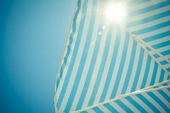 Holiday Sun through the sunshade Royalty Free Stock Photo