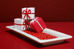 Holiday Surprises. Gift boxes and candy on a red background Stock Image