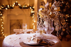 Holiday table decorated in winter style. Christmas background. Copy space at left Royalty Free Stock Photography
