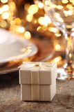 Holiday table detail. Close up of gift on holiday table setting royalty free stock photo