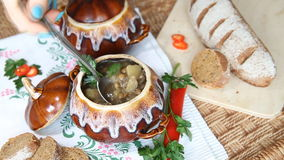 On holiday table pot with meatless soup. Scoop up full spoon soup. Slow video. stock video