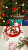 Holiday table setting and Christmas tree Royalty Free Stock Photography