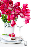 Holiday table setting with pink tulips Stock Photos