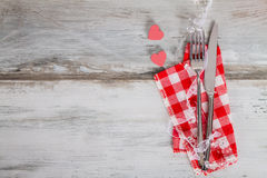 Holiday Table Setting in red napkin with hearts Royalty Free Stock Photography