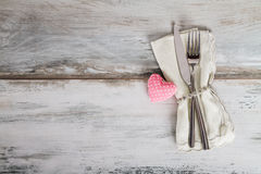 Holiday Table Setting with rose heart on gray background. Holiday Table Setting on wood Stock Image