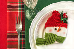 Holiday table setting with snowman and Christmas decorations. Royalty Free Stock Photos