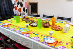 Holiday table with snacks, children holiday celebration Royalty Free Stock Images