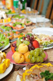 Holiday table with tasty food Royalty Free Stock Photos