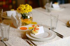 Holiday table with yellow flowers Stock Image