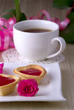 Holiday Tartlets with jam near the cup of tea Stock Photography