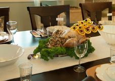 Holiday Thanksgiving Meal Turkey Table. With place settings ready for a family to sit and eat Royalty Free Stock Image