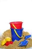 Holiday Time with space for text. A holiday image of buckets and spades with sand from a beach royalty free stock photo