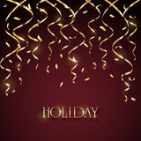 Holiday tinsel and confetti on dark red background Royalty Free Stock Photo