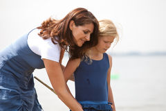 Holiday together. Mother and daughter together by the seaside Stock Photography