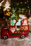 Holiday traditional food bakery. Decorative toy car with christmas Gingerbread cakes in cozy warm decoration with garland lights stock photo