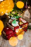 Holiday traditional food bakery. Decorative toy car with christmas Gingerbread cakes in cozy warm decoration with garland lights.  stock images