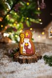 Holiday traditional food bakery. Gingerbread catholic preacher in cozy decoration with garland lights and cup of hot coffee.  stock images