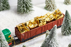 Holiday train carries gifts for Christmas Stock Images