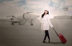 Holiday travel at airport in winter Stock Images