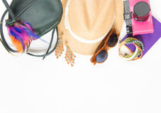 Holiday, travel background. Hipster stuff. Green cross bag, straw hat, retro brown sunglasses, colorful headband, pink Royalty Free Stock Images