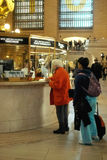 Grand Central Terminal Holiday Travelers New York. Two travellers at information booth at Grand Central Terminal, New York City royalty free stock images