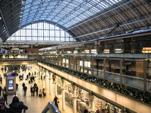 Holiday travelers stroll through St Pancras station, London, as seen from above. Stock Images
