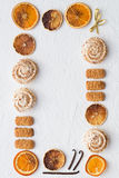 Holiday Treats Frame - Meringues, Cookies and Citrus Fruit Chips. On a White Backgroound Stock Photography