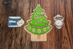 Holiday tree  and ornaments with various message essential  retro tags, isolated on old classic vintage hardwood background Royalty Free Stock Photos