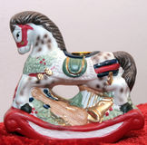 Holiday Trinket. Close-up of a christmas toy / decoration of rocking horse Royalty Free Stock Image