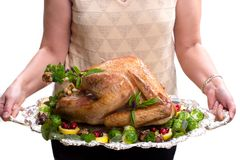 Holiday turkey. Garnished roasted turkey on platter is ready to be served Royalty Free Stock Image