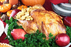 Holiday Turkey Dinner. Thanksgiving or Christmas turkey dinner with fresh red pears and parsley Royalty Free Stock Images