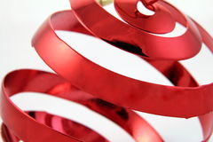 Holiday Twist. Red Christmas ornament Royalty Free Stock Images