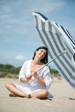 Holiday umbrella. Woman relaxing with umbrella on holiday royalty free stock photos