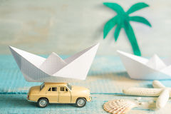 Holiday vacation concept with abstract origami boat and tropical beach Stock Photo