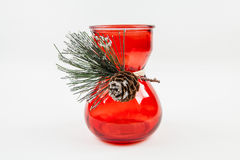 Holiday Vase. A vase decorated with a pine cone for the holidays Stock Photos