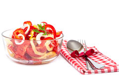 Holiday vegetable salad with a napkin, spoon and fork. Royalty Free Stock Photo