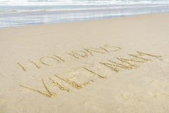 Holiday Vietnam written in sand. Holiday Vietnam written on the sand in Danang beach, Vietnam Stock Photography